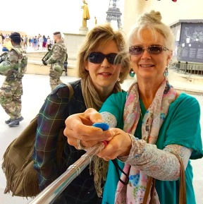 learning to use selfie stick, paris security in background