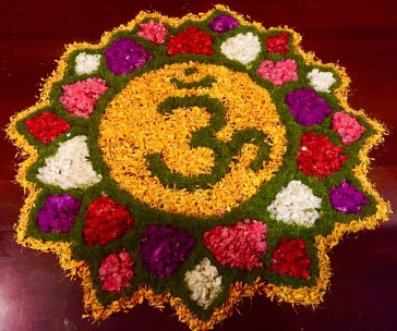 ohm in flowers on the floor