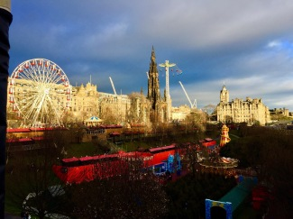 edinburgh skyline with christmas fair and market
