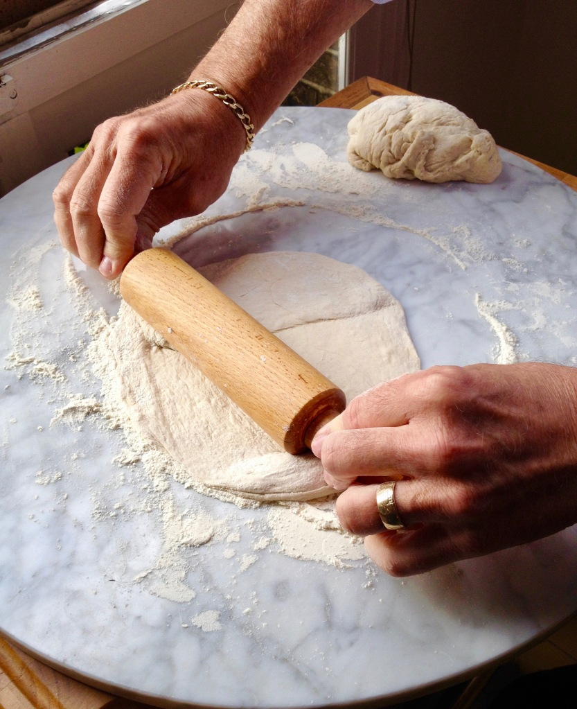 take sections of dough and begin to roll into a circle